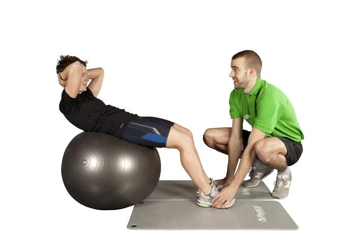 Fitness_instructor_training_adult_male_on_fitball.jpg