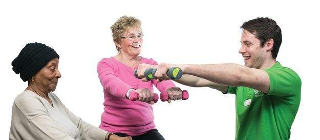 Homepage_Panels-Adult_male_and_female_on_fitball_with_dumbbells.jpg