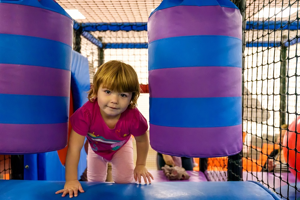 A girl enjoying exploring the Better Play area at Bath Sports and Leisure Centre